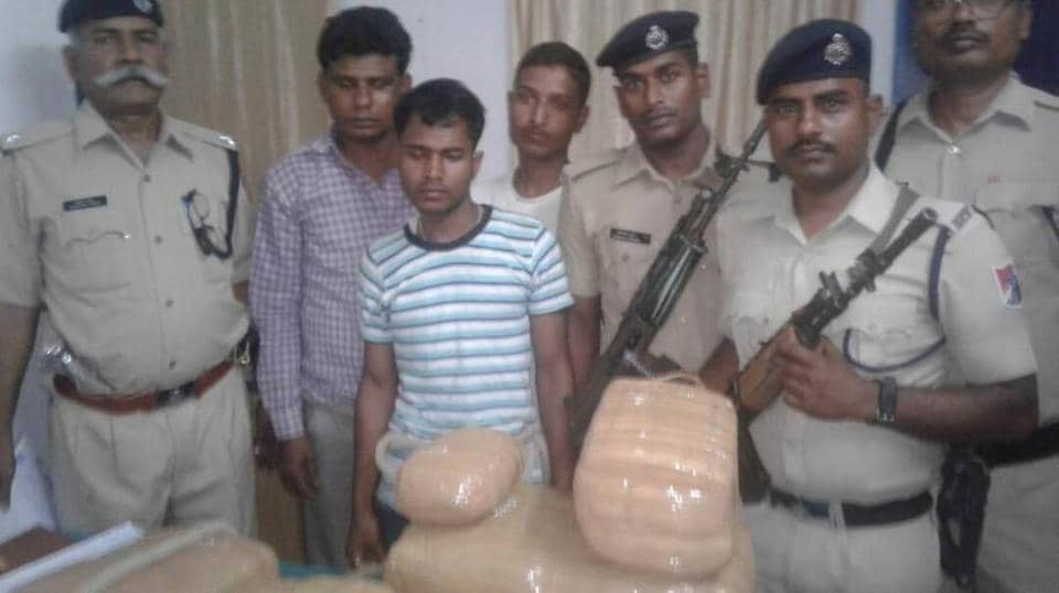 Railway Protection Force  personnel with the arrested persons and the seized contraband.