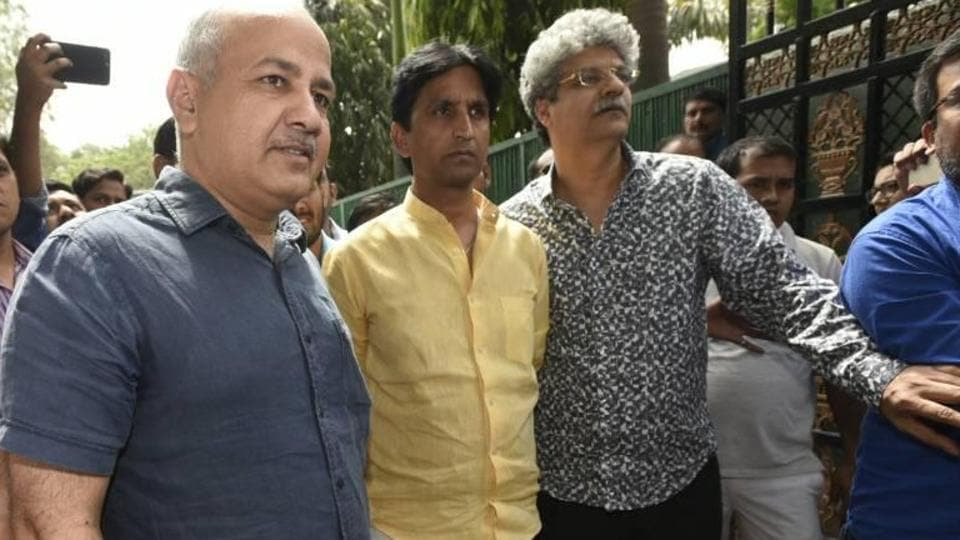 Deputy chief minister Manish Sisodia with Kumar Vishwas after the meeting of AAP's political affairs committee.