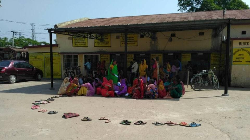 To avoid the scorching sun, villagers in Purnia place their slippers and wait for their turn to apply for ration cards.