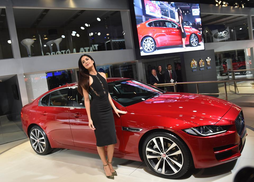 Actor Katrina Kaif with Jaguar entry-level sedan XE at the 2016 Auto Expo in Greater Noida on February 3, 2016.