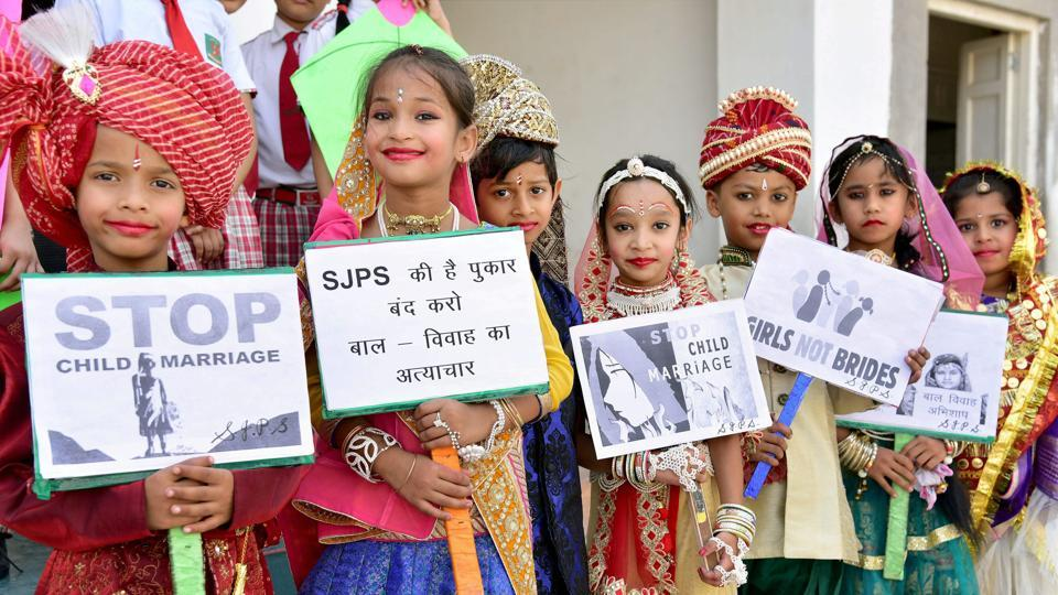 School children take part in an awareness campaign to stop child marriage in Bikaner.