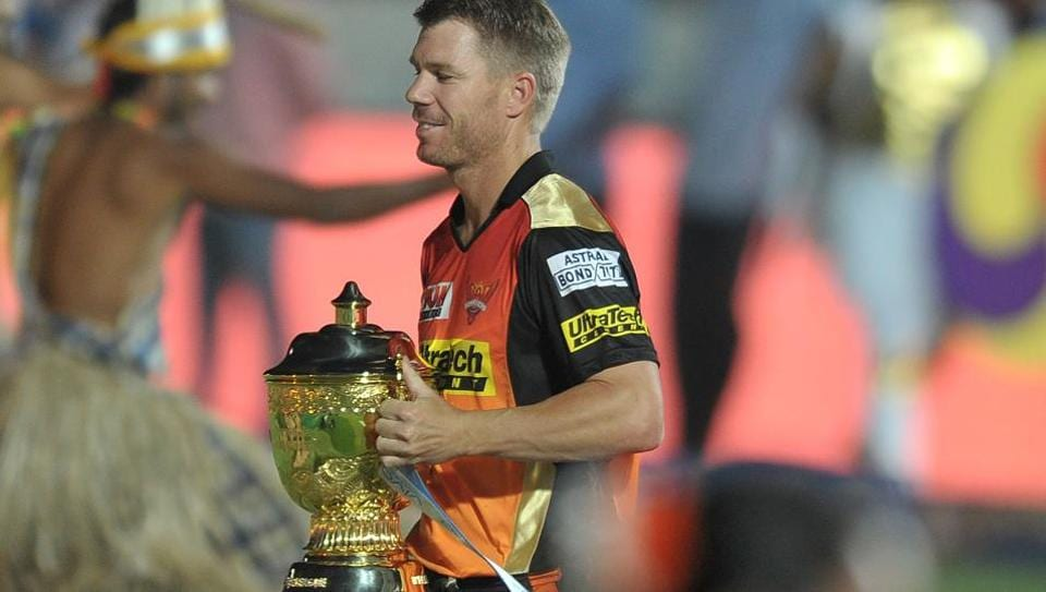 Sunrisers Hyderabad captain David Warner carries the trophy during the opening ceremony of the 2017 Indian Premier League at the Rajiv Gandhi International Cricket Stadium in Hyderabad on April 5, 2017.
