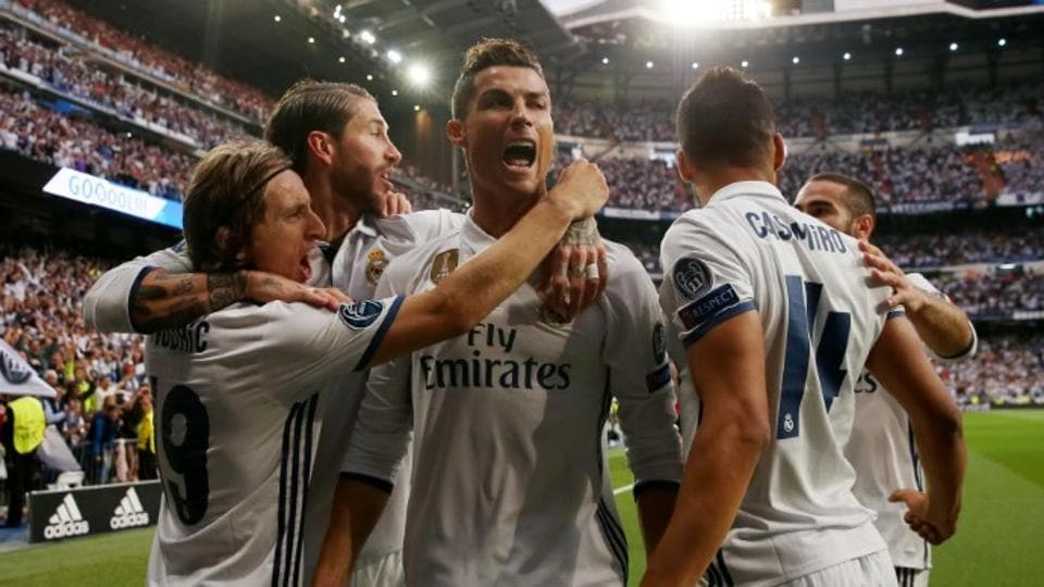 Real Madrid C.F.'s Cristiano Ronaldo celebrates with teammates after scoring against Atletico Madrid in their UEFAChampions Leaague semifinal first leg at the Santiago Bernabeu on Tuesday.