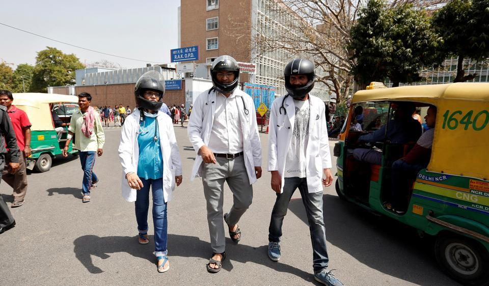 Doctors in AllMS, New Delhi, wore helmets at work in March 2017 in protest against lack of security measures.