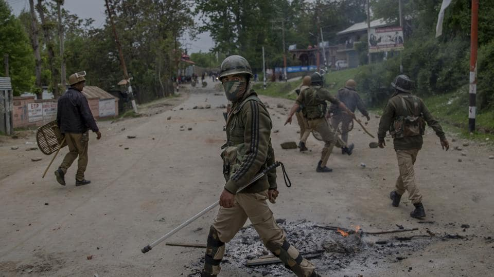 Indian policemen clear the area after a protest in Budgam, about 20 km southwest of Srinagar.