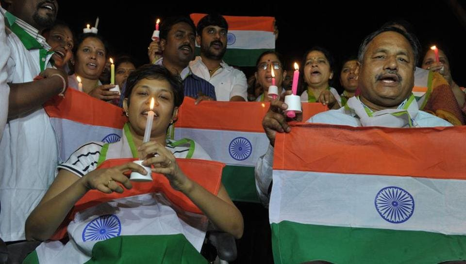 People holding the national flag take out a candlelight vigil  in Hyderabad on May 2 after the death of two Indian soldiers in Kashmir. The Indian Army has accused Pakistan of killing the soldiers and mutilating their bodies in an