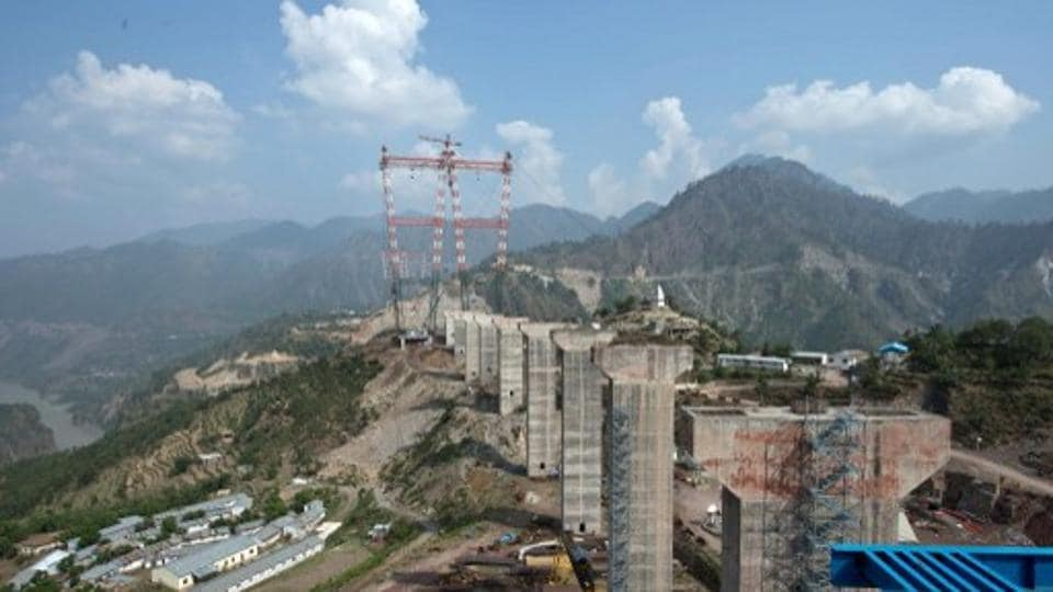 In this photograph taken on July 5, 2014, the under-construction world's highest railway bridge is pictured over the Chenab river in Kauri in northern Jammu and Kashmir state. Indian engineers are toiling in the Himalayas to build the world's highest railway bridge which is expected to be 35 metres taller than the Eiffel Tower when completed.