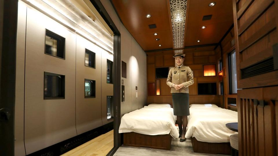 This picture taken on March 16, 2017, shows a crew member introducing a suite room of the Train Suite Shiki-Shima, operated by East Japan Railway, in Tokyo during a press preview.