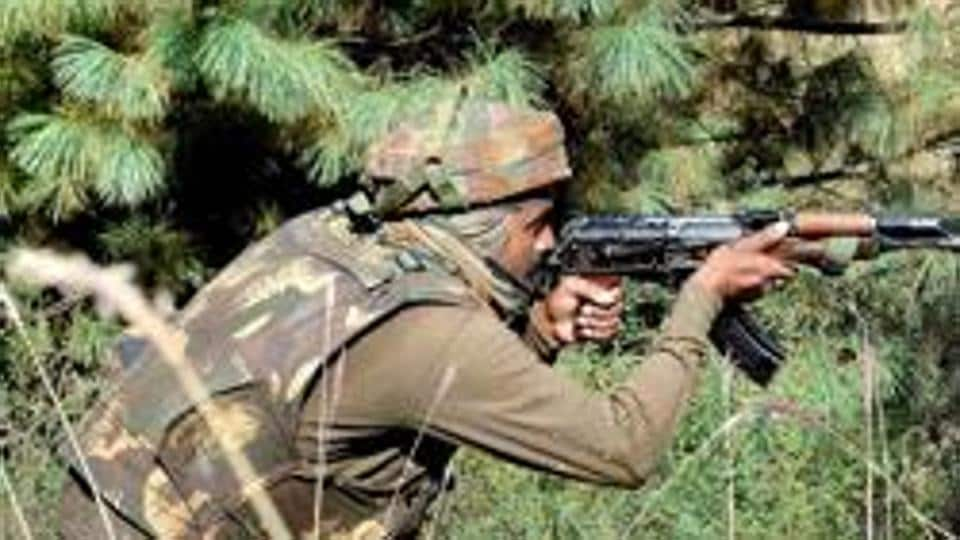 Soldier takes position during an encounter with militants in Keran sector of Jammu and Kashmir.