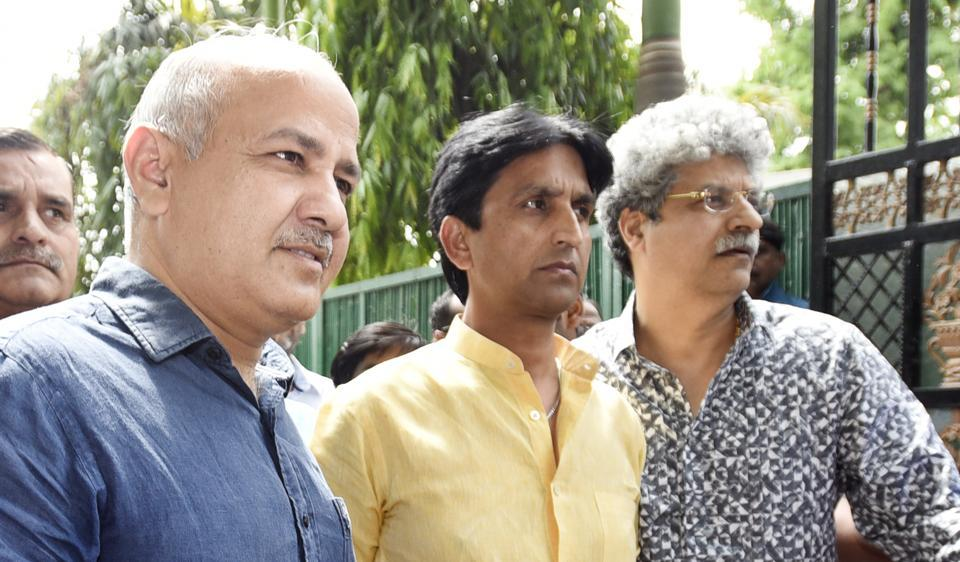Delhi deputy chief minister Manish Sisodia (left) and AAP leader Kumar Vishwas (centre) after the PAC meeting at CM Arvind Kejriwal's residence in Civil Lines.