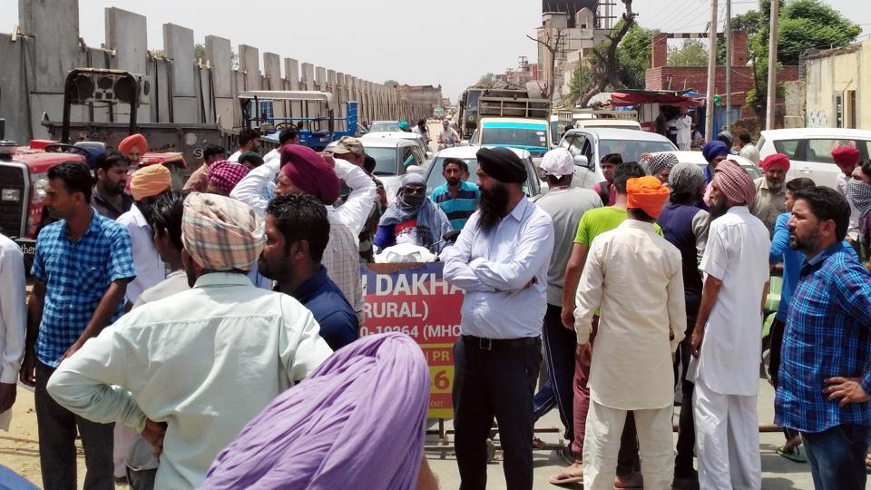 Protesters blocking traffic on the LudhianaFerozepur road near Baddowal in Ludhiana on Tuesday.