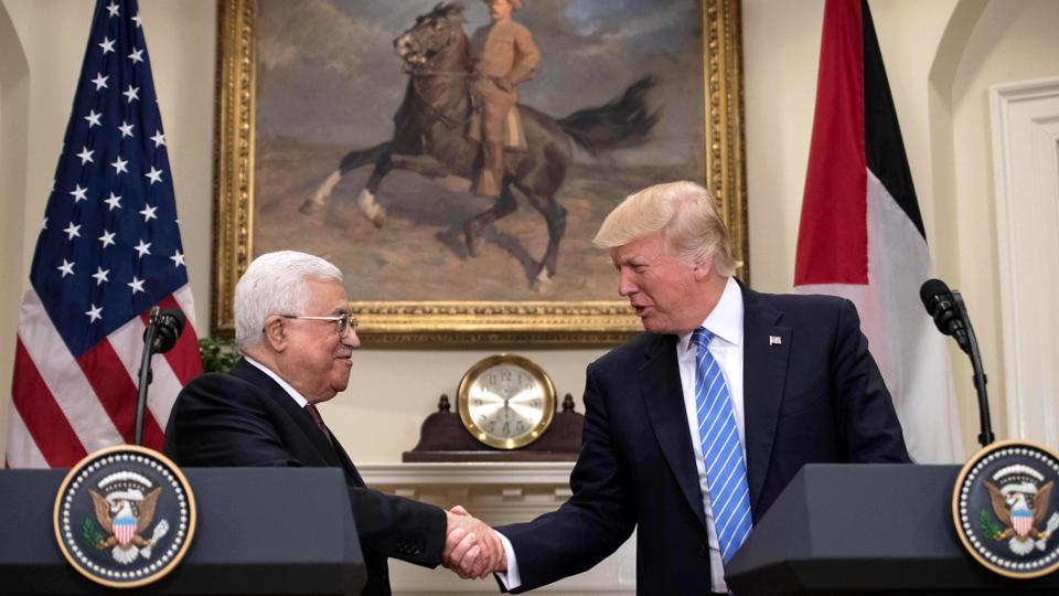 US President Donald Trump and Palestinian Authority President Mahmud shake hands in the Roosevelt Room during a joint statement at the White House in Washington, DC, on May 3, 2017.