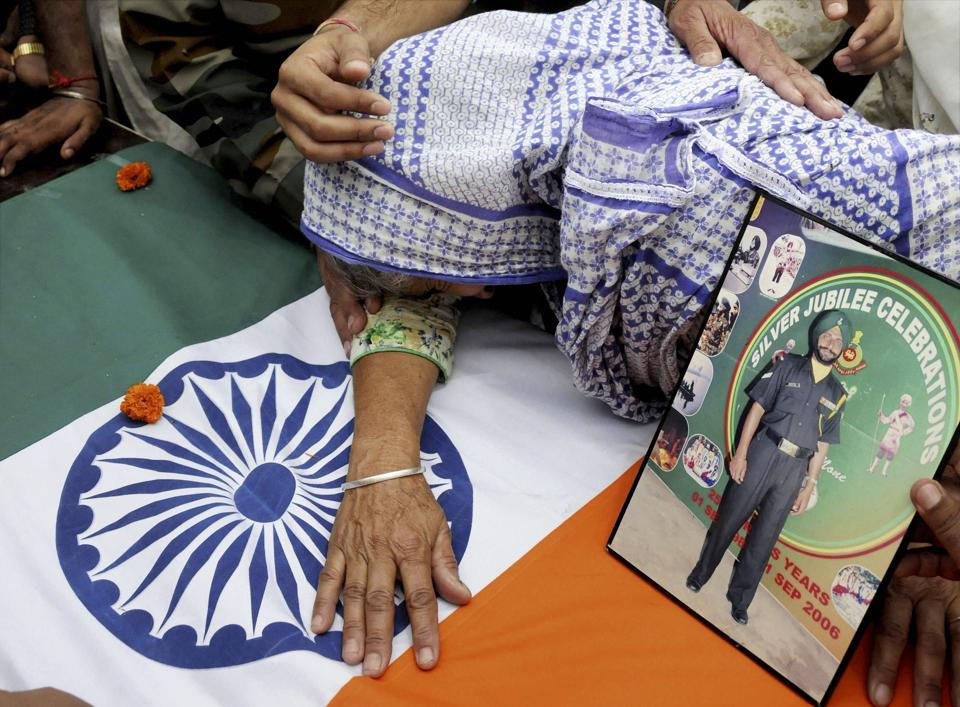 Naib subedar Paramjit Singh's mother breaks down as his body arrives in Vain Poin village in Punjab's Amritsar on Tuesday. Singh was one of the two soldiers killed and mutilated in a cross-border raid by the Pakistan army a day earlier.