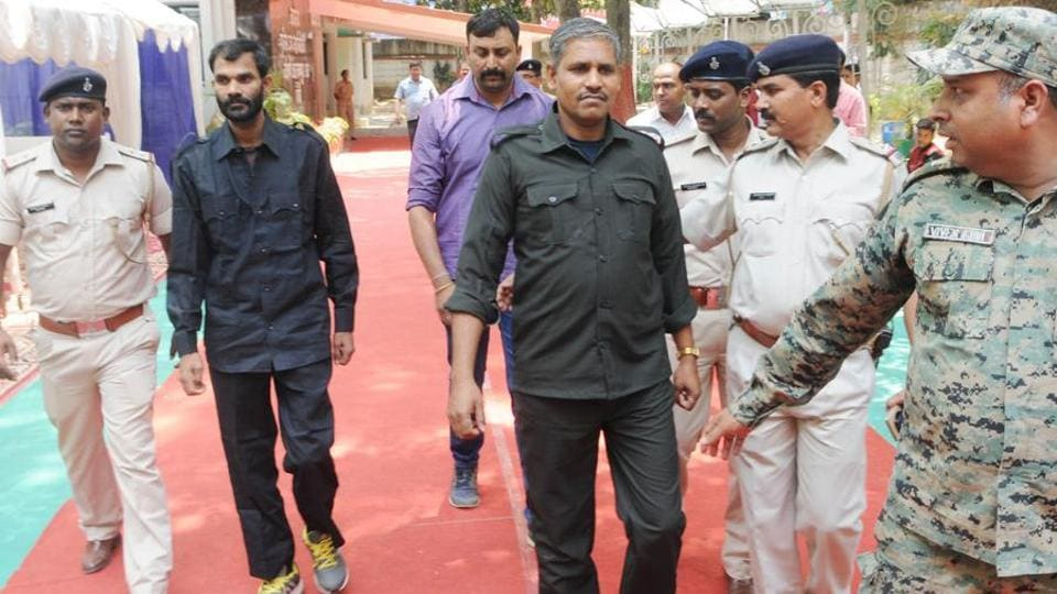 Extremist Nakul Yadaw (R) and Madan Yadaw, a zonal commander, surrender in Ranchi on Thursday.