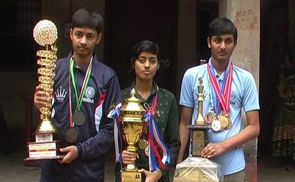 Chess prodigies Kumar Gaurav, Garima Gaurav  and Saurav Anand display their trophies and medals .