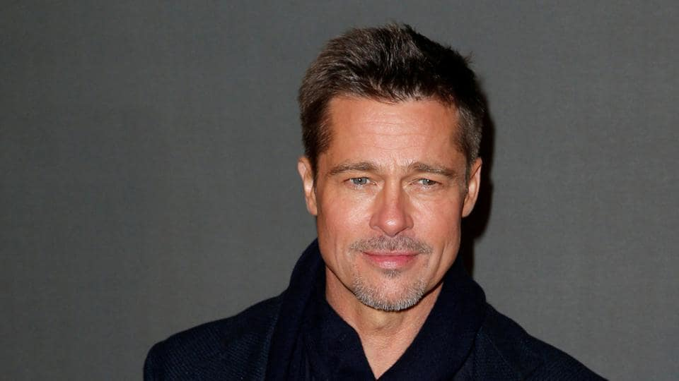 Actor Brad Pitt poses at the premiere of the film Allied in Paris, France on November 20, 2016.