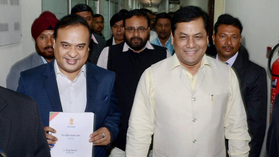 Health and family welfare minister of Assam Himanta Biswa Sarma  (L) with Assam chief minister Sarbananda Sonowal.