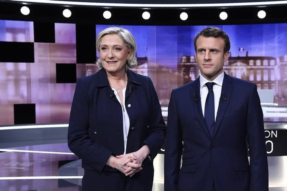 Marine Le Pen of the French National Front (FN) party and Emmanuel Macron, head of the political movement En Marche! in the studios of French television station France 2, and French private station TF1 in La Plaine-Saint-Denis, near Paris.
