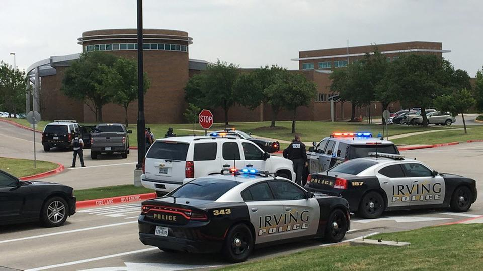 Officers work at a shooting scene on the North Lake College campus in Irving, Texas, Wednesday, May 3, 2017. The situation prompted a lockdown at the school in the Dallas suburb.