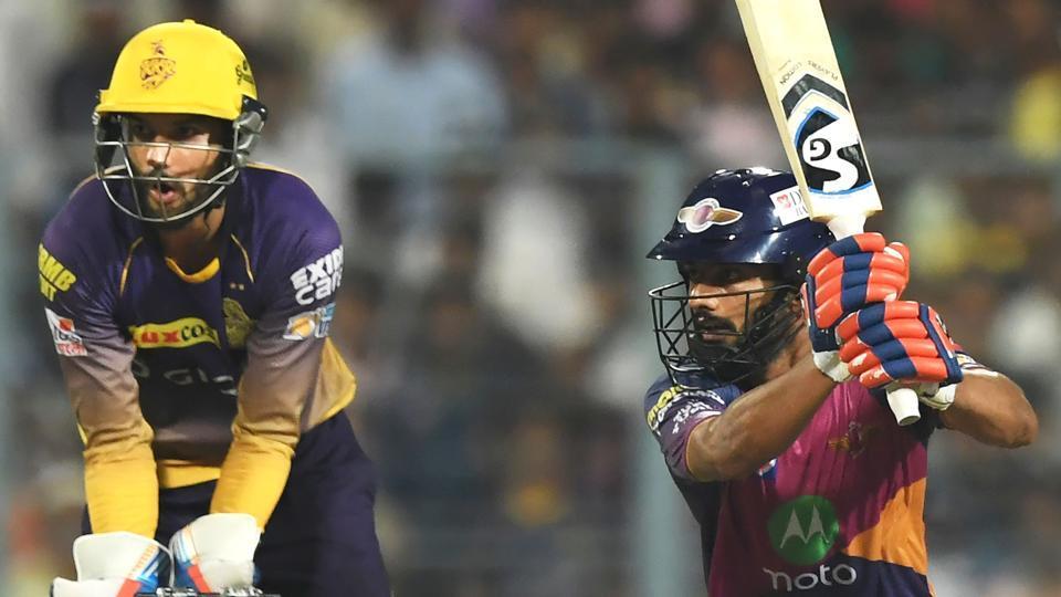 Rising Pune Supergiant's Rahul Tripathi plays a shot as Kolkata Knight Riders keeper Sheldon Jackson looks on during their IPL 2017 match at Eden Gardens in Kolkata on Wednesday.