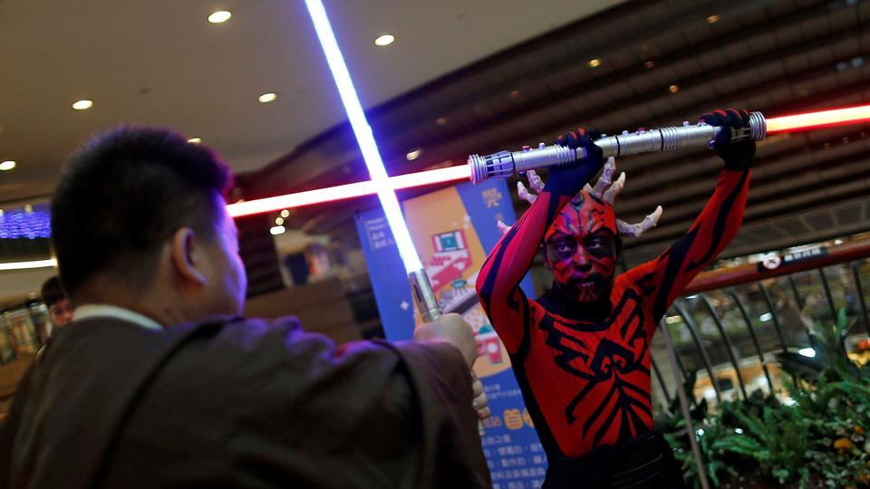 Fans dressed as the characters from Star Wars react during Star Wars Day in Taipei.