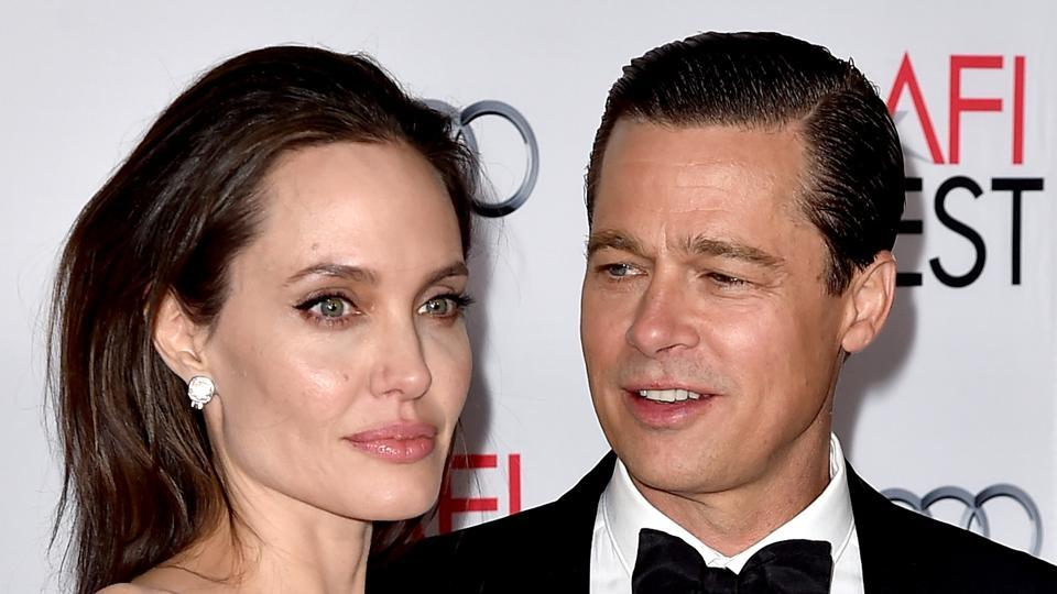 This file photo taken on November 4, 2015 shows actor/director Angelina Jolie Pitt (L) and her estranged husband actor Brad Pitt.