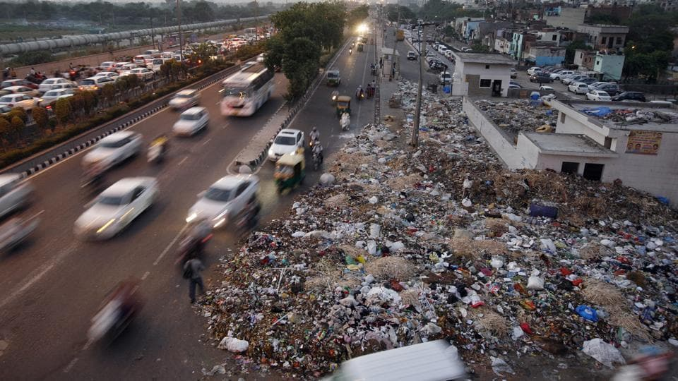 Heap of garbage are strewn along the roadside near Geeta Colony. Repeated strikes by sanitation workers and poor garbage management have led to Delhi scoring poorly on the Swachh rankings.