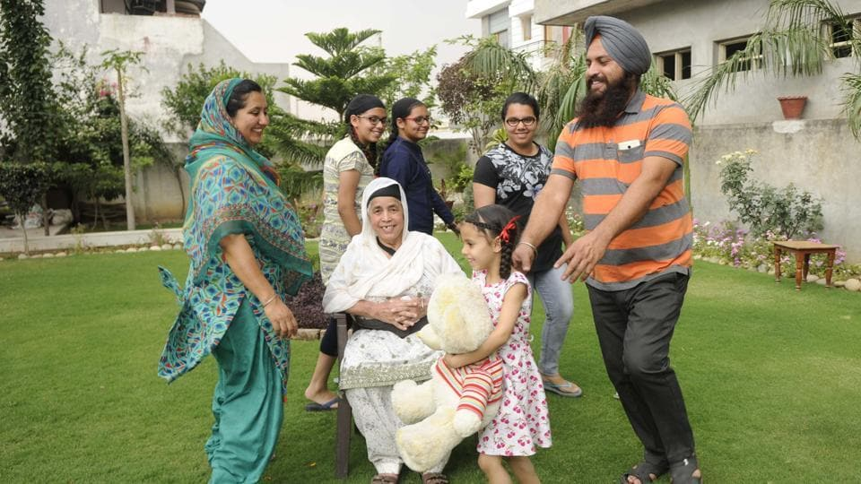 Businessman Amritpal Singh Sodhi and his wife Gurwinder Kaur (left) with their four daughters in Fatehgarh Sahib.