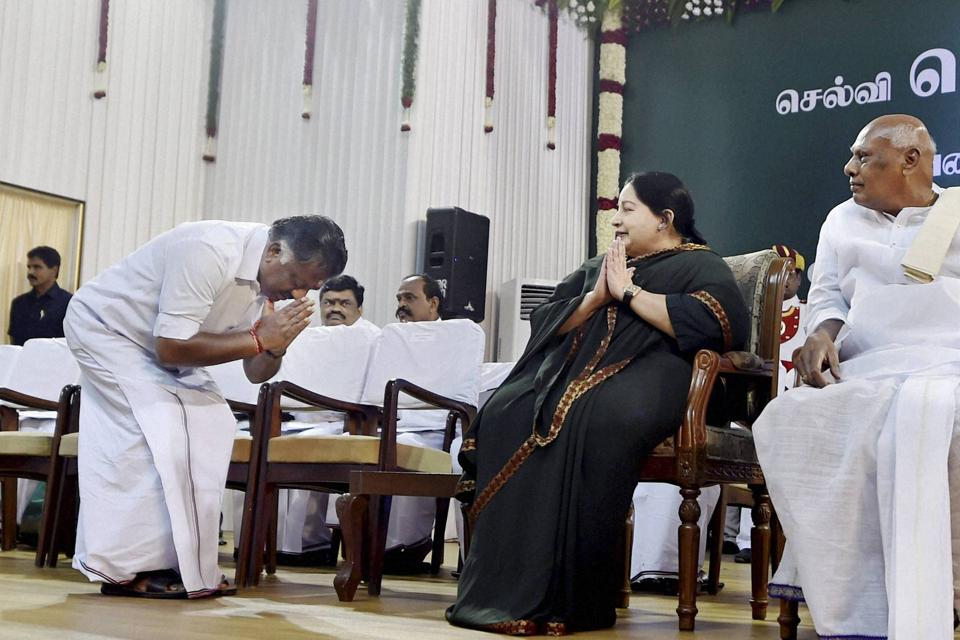 O Panneerselvam greeting AIADMK supremo J Jayalalithaa ahead of taking the oath of secrecy as Finance Minister at the swearing in ceremony at Madras University Centenary Auditorium in Chennai on 23 May 2016.