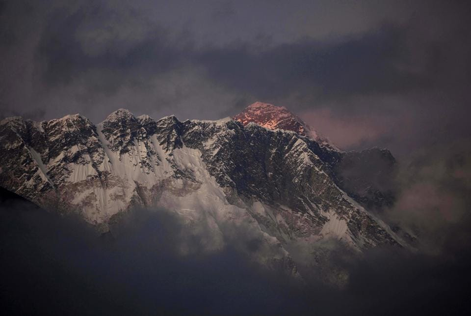 File photo of the sun setting on Mount Everest.