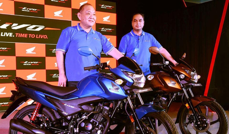 Honda Motorcycle president and CEO Keita Muramatsu (L), at the launch of new model 'Livo' in New Delhi. The company expects to cross 5.5 million cumulative sales of Shine this month.