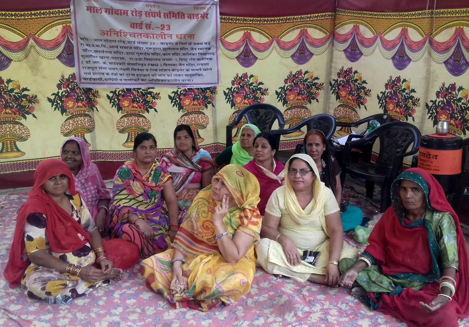 Women demand the closure of a liquor shop in a residential areas in Barmer.