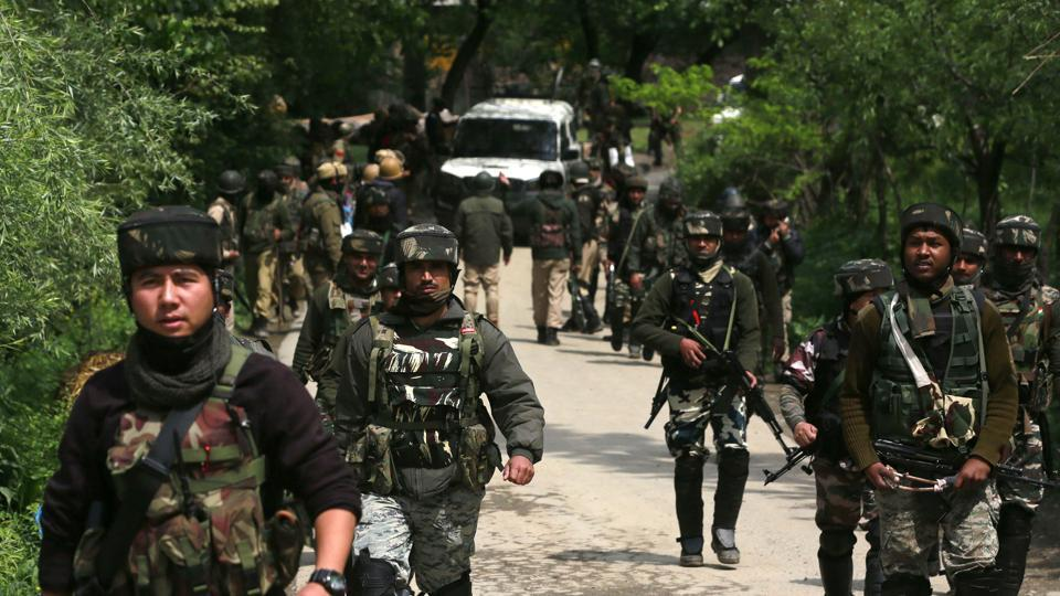 Soldiers patrol during an operation against militants in Shopian district, south of Srinagar.