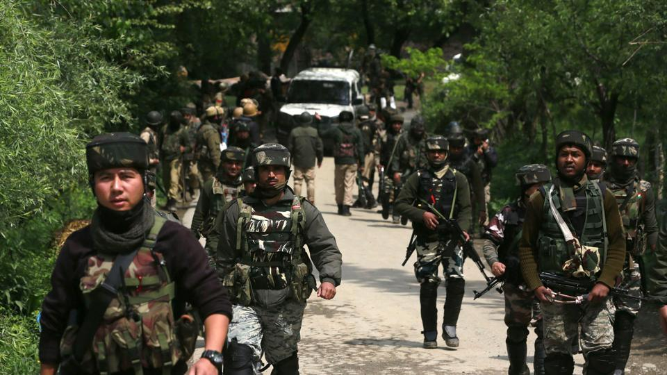 Paramilatary soldiers patrol during an operation against militants in Shopian district on Thursday.