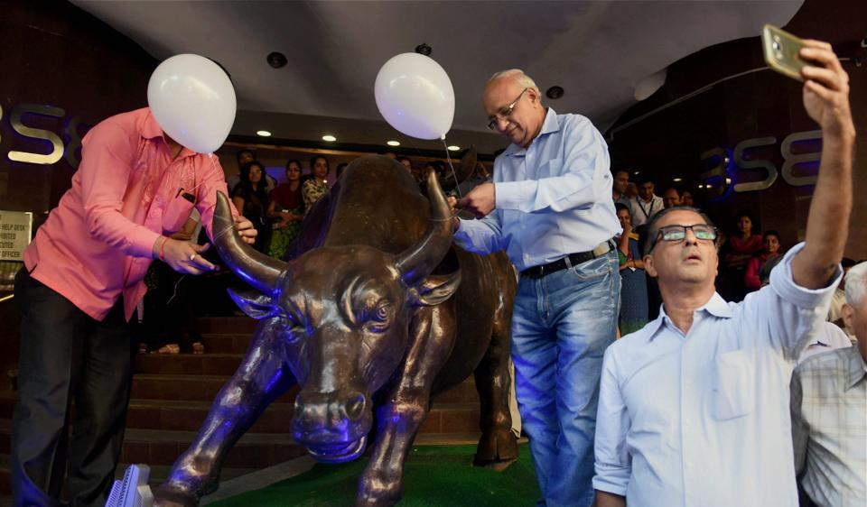People celebrate at BSE as Sensex surges.