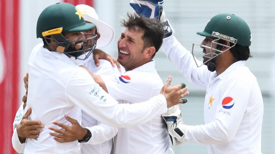 Yasir Shah (C) celebrates with Pakistan teammates after the dismissal of a WestIndies batsman on the 4th day of the 2nd Test at Kensington Oval.