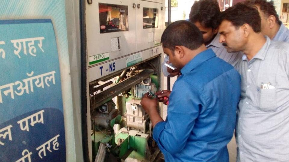 Fuel dispensers being checked at a petrol pump near Jawahar Bhawan in Lucknow on Thursday.