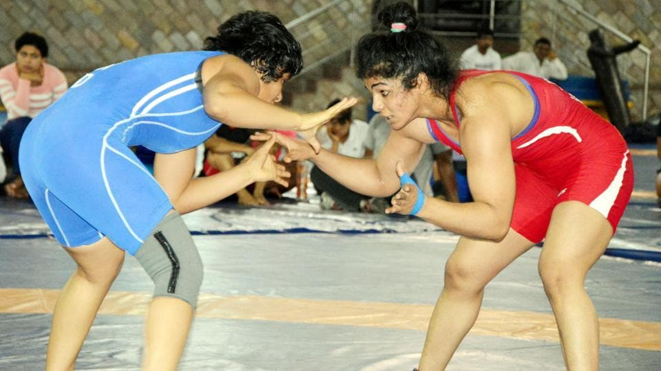 Sakshi Malik (R) didn't have to break much sweat as she defeated Manju Kumari 10-0 to book her place in the Asian Championship.