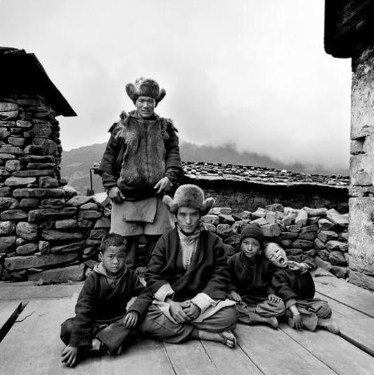 Sonam Wangdi (standing) and members of his family in Sakteng valley, 2004.  (photo courtesy: sERENA chopra)