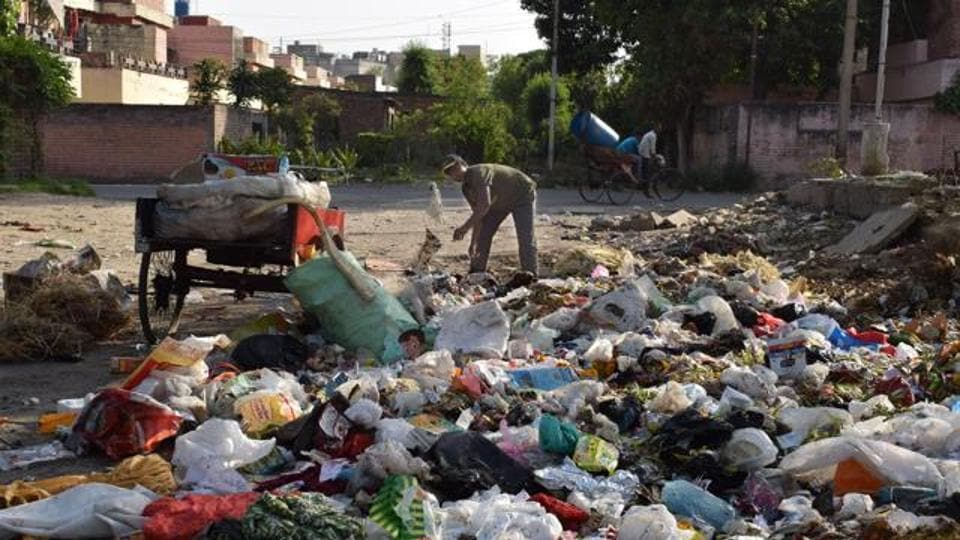 A dumping site overflowing with litter in a Jalandhar locality.