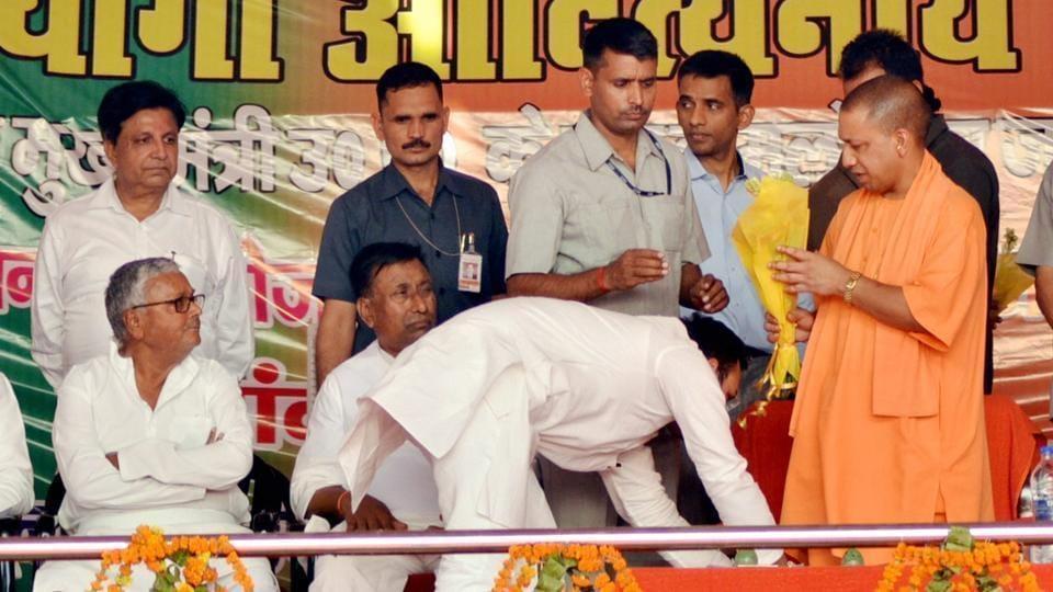 MLA Amanmani Tripathi touching the feet of CMYogi during the latter's visit to Gorakhpur recently.