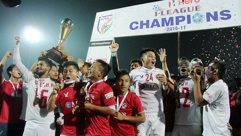 Players of Aizawl Football Club celebrate with the trophy after they won the Hero I-League following the season-ending game against Shillong Lajong FC in Shillong on April 30.