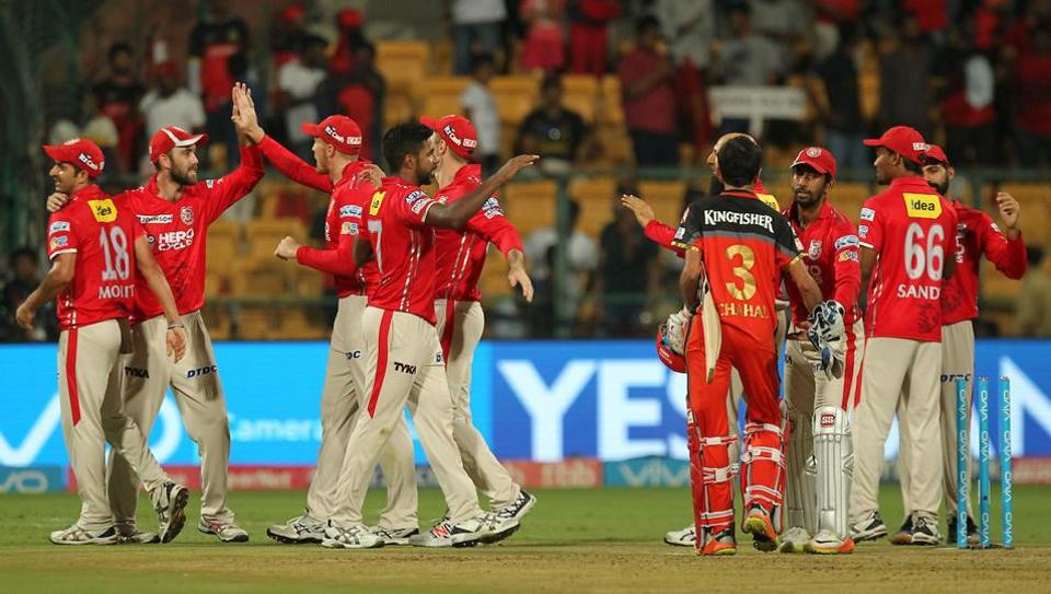 Kings XI Punjab (KXIP)players celebrate their 19-run win in the2017 Indian Premier League (IPL)match againstRoyal Challengers Bangalore (RCB)at the M Chinnaswamy Stadium in Bangalore onFriday.