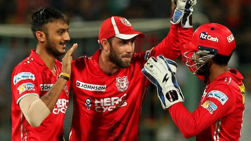 Axar Patel of Kings XI Punjab celebrates the wicket of Shane Watson of Royal Challengers Bangalore. Get full cricket score of Royal Challengers Bangalore vs Kings XI Punjab here.