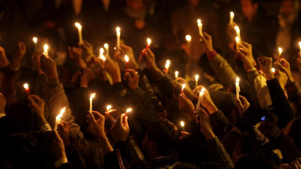 People held a candle light march in New Delhi after the death of Delhi gang rape victim in December, 2012.