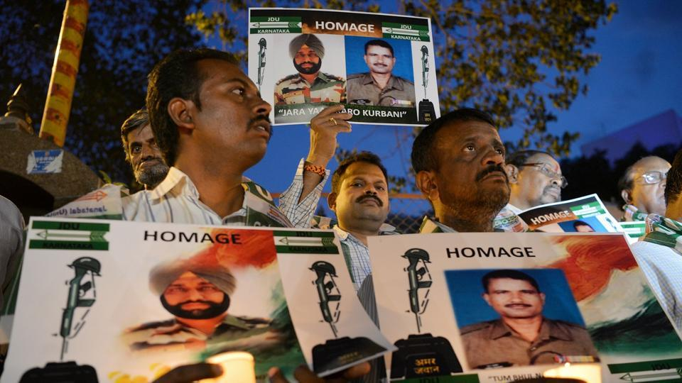 Activists stage a candlelight vigil in Bangalore to condemn the mutilation of Indian soldiers' bodies by Pakistani soldiers in Kashmir.