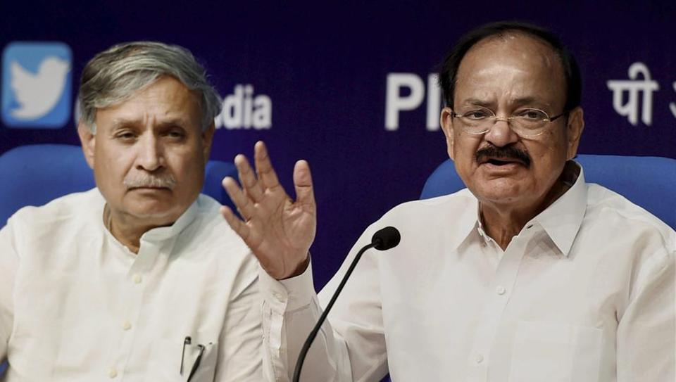 Union minister M Venkaiah Naidu addresses a press conference in New Delhi along with his deputy Rao Inderjit Singh.