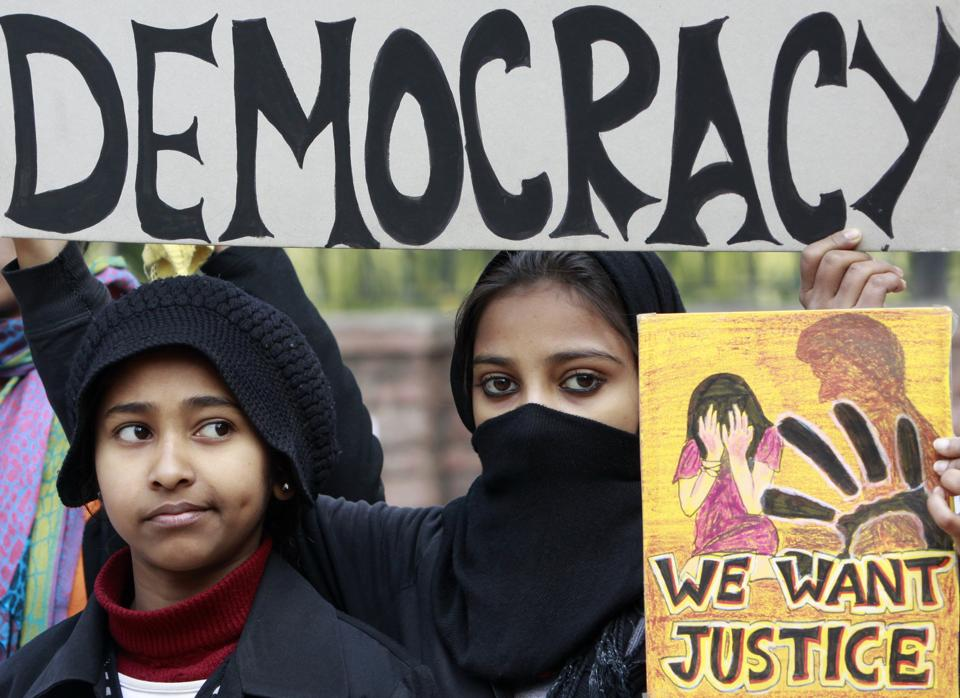 Students observe 'Black Day' at Jantar Mantar to seek justice for the Delhi gang rape victim, in New Delhi, January 3, 2012