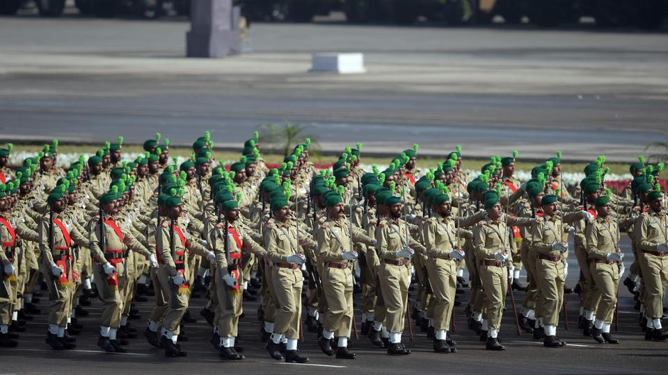 Pakistani army soldiers march past during a Pakistan Day military parade in Islamabad on March 23.
