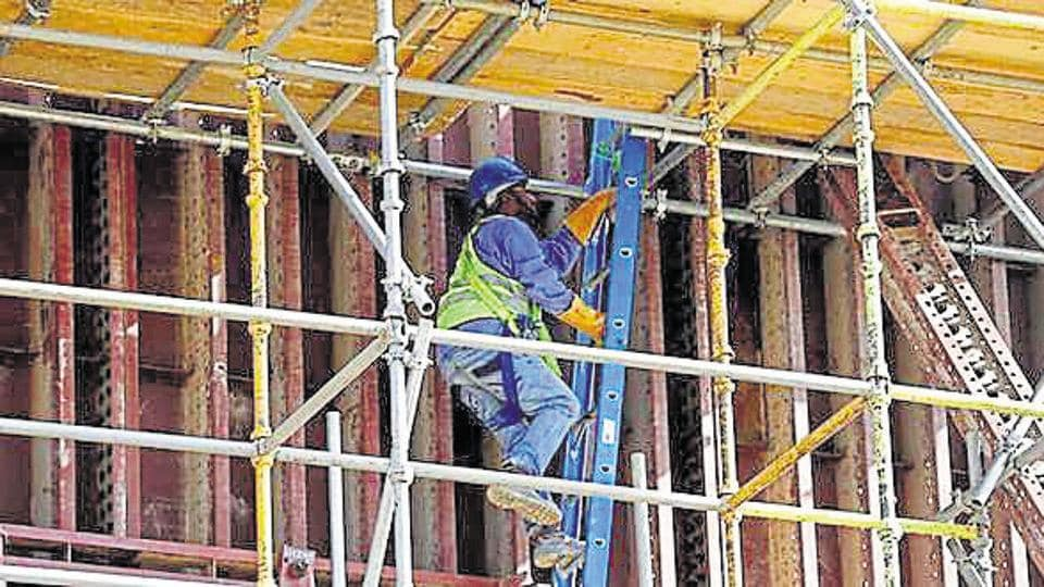 An Asian labourer climbs a ladder as he works at the construction site of a building in Riyadh, Saudi Arabia. Saudi Arabia is the top destination for Indians migrating for labour work overseas.